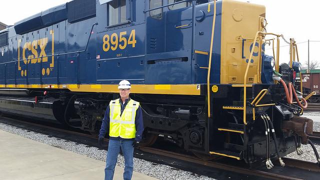 Railinc CFO Yates Parker in front of a CSX locomotive.